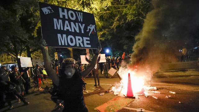 הפגנות בוושינגטון ליד הבית הלבן (צילום: AP)