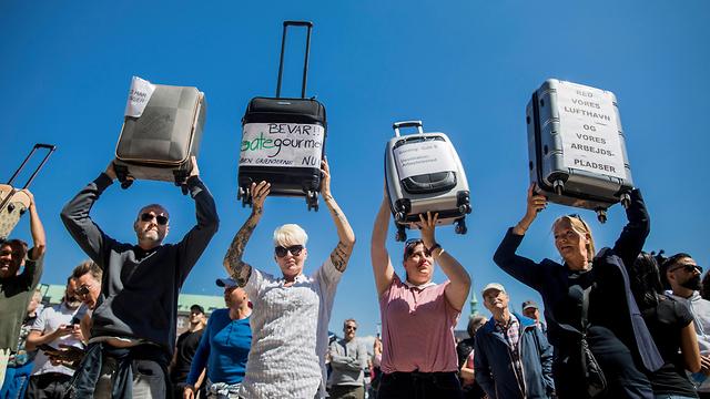 הפגנה קופנהגן דנמרק נגיף קורונה הקורונה (צילום: רויטרס)