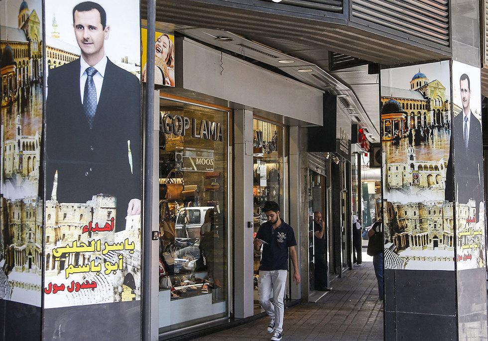 נשיא סוריה בשאר אסד דיוקן דמשק (צילום: AFP)