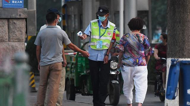 שוק מזון בסין נסגר עקב הקורונה (צילום: AFP)