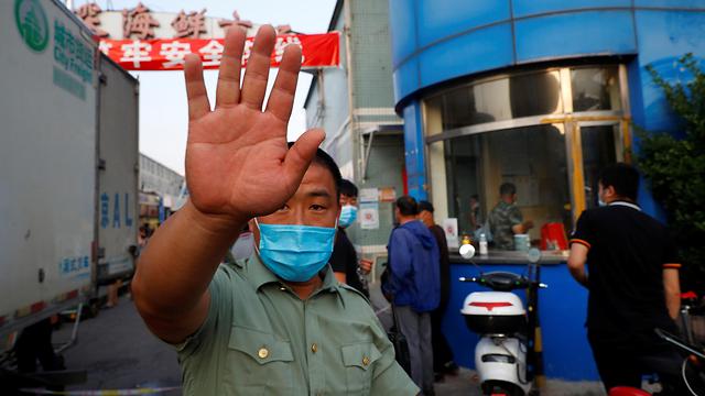 שוק מזון בסין נסגר עקב הקורונה (צילום: רויטרס)