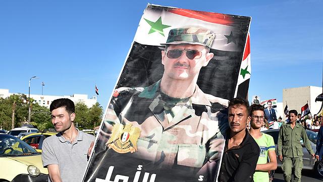 סוריה הפגנת תמיכה ב בשאר אסד ב דמשק נגד הסנקציות האמריקניות החדשות (צילום: EPA)