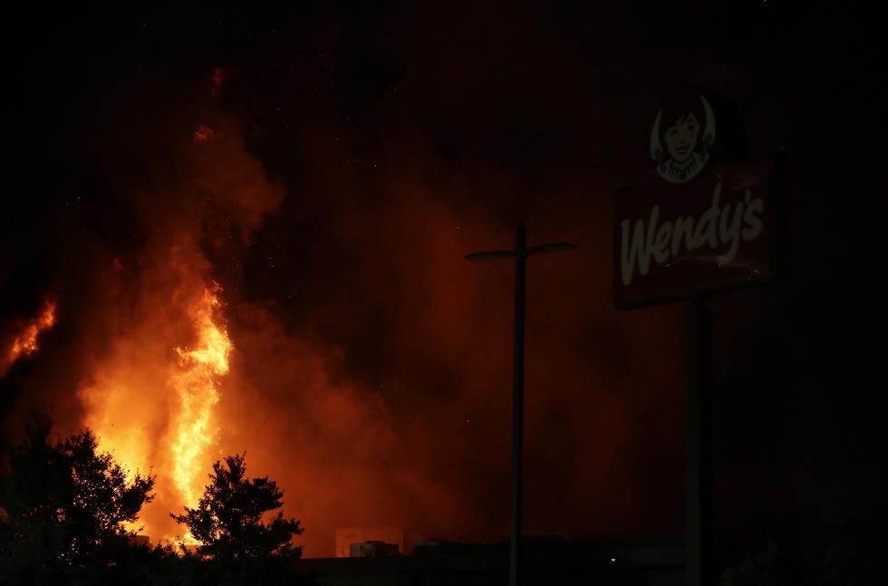 אטלנטה הפגנות מחאה סניף וונדיס הוצת שריפה ריישרד ברוקס (צילום: AP)