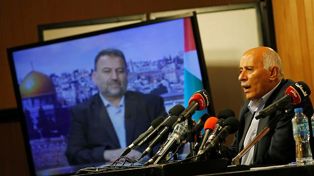 ג'יבריל רג'וב וסאלח אל-עארורי (צילום: רויטרס)