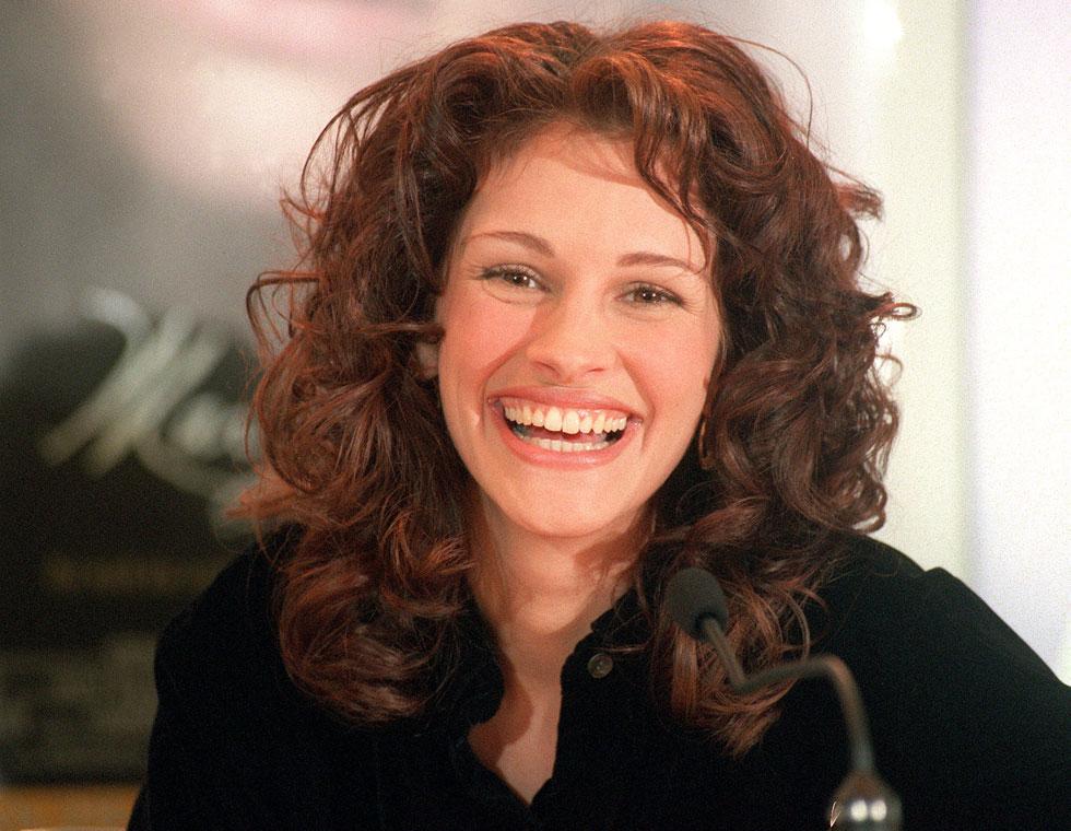 אף אחד לא נשאר אדיש לחיוך הממיס ולרעמת השיער המפוארת. 1996 (צילום: AP)