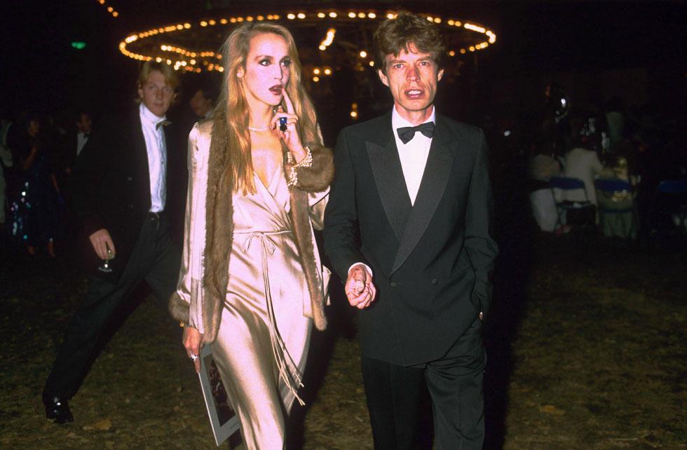 שנות ה-80: הזוגיות הפוטוגנית והסקסית של מיק ג'אגר וג'רי הול (צילום: rex/asap creative)
