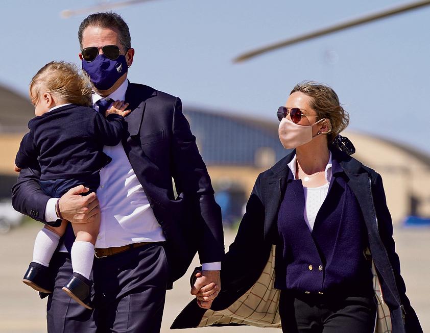 האנטר עם אשתו השנייה מליסה ובנם | צילום: איי פי