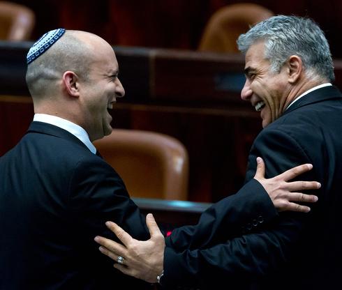 Yamina chief Naftali Bennett and Yesh Atid head Yair Lapid