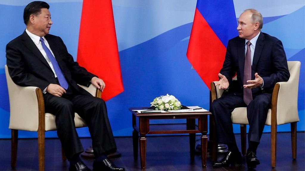 נשיא רוסיה ולדימיר פוטין עם נשיא סין שי ג'ינפינג