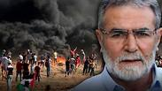 Ziad Al-Nahala the leader of the Islamic Jihad in Gaza with the unrest on the Gaza fence in the back