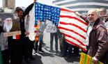 Protesters in Iran burn American flag