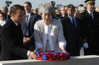 Macron and May lay a wreath at a Franco-British ceremony in Ver-Sur-Mer to mark 75th anniversary of D-Day, June 6, 2019