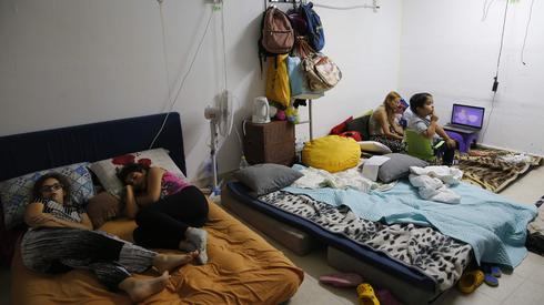 Israeli children near the Gaza border turn their bomb shelter into a bedroom