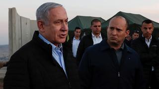 Yamina leader and outgoing defense minister Naftali Bennett and Prime Minister Benjamin Netanyahu