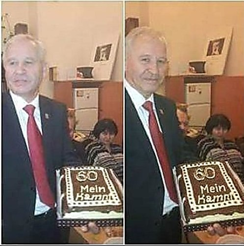 Marushchinets holding a 'Mein Kampf' cake