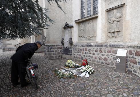 The memorial plaque against anti-semitism underneath the Judensau