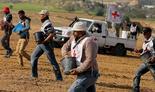Palestinian farmers along the Israel-Gaza border