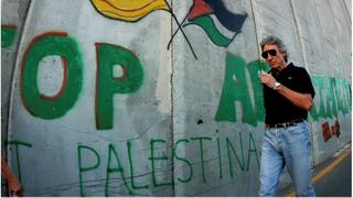 Roger Waters walks along the Israeli barrier in the Palestinian city of Bethlehem