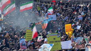 Iranians attend a rally in Tehran to mark the anniversary of the 1979 revolution