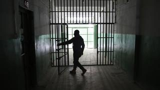 A guard opens a door inside a prison that holds foreign prisoners, suspected of being part of the Islamic State, in Hasaka