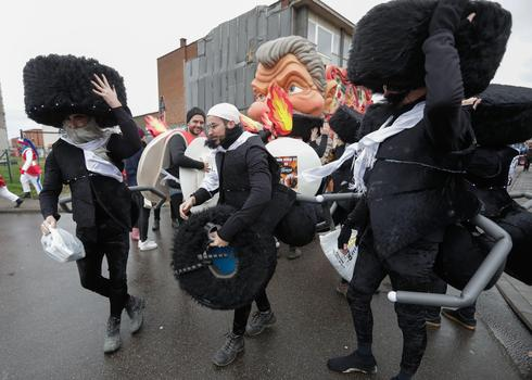 People portray Hassidic Jews as ants at the parade in Aalst, Feb. 23 2020