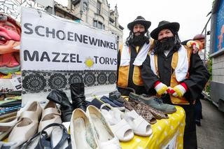 People dressed as caricatures of Orthodox Jews pretend to sell shoes at the parade in Aalst, Feb. 23 2020