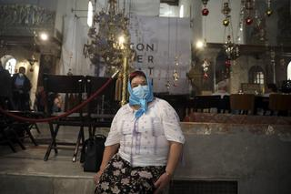 A visitor wears a mask at the Church of the Nativity in Bethlehem after a suspected coronavirus outbreak in the city, March 5, 2020
