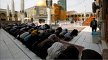 Shi'ite Muslim pilgrims pray at Imam Ali Shrine after Iraq's Najaf authorities banned all non-residents visits