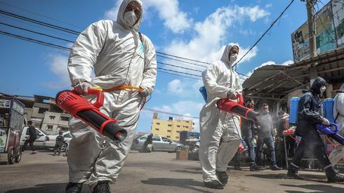 Spraying disinfectant against coronavirus in Gaza
