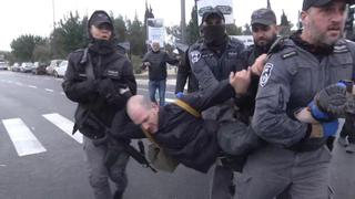 A man is arrested at the protest outside the Knesset