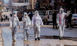 Medical workers oversee disinfection in Damascus, Syria