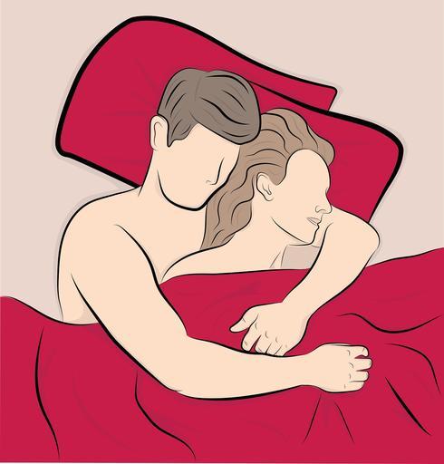 איש ואישה שוכבים מחובקים במיטה