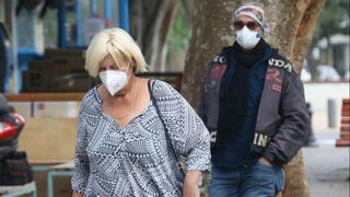 Civilians wearing surgical masks in Tel Aviv