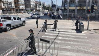 Police erect barricades at the entrance to Bnei Brak