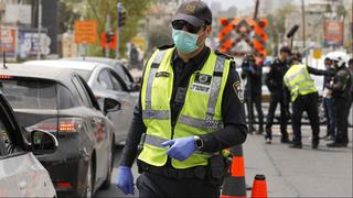 Police officer with a surgical mask in Bnei Brak
