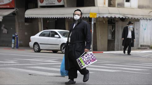 A Haredi man in Bnei Brak with a surgical mask