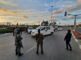 Police man a roadblock near Rishon Lezion as Israel goes into lockdown for the first few days of Passover