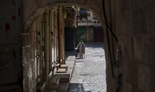 A worshiper walks towards the Church of the Holy Sepulchre in Jerusalem