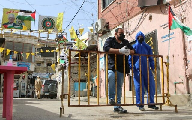 Members of armed Palestinian factions, in coordination with Lebanese security forces, impose a lockdown on the Wavel camp for Palestinian refugees in Lebanon's eastern Bekaa Valley, on April 22, 2020, after the UN announced the first confirmed case of coronavirus there