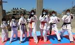 Sheikheleid family members train in their makeshift rooftop karate club in the Rafah Governorate of the Gaza Strip