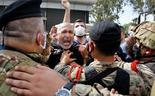 Anti-government protesters scuffle with Lebanese army soldiers in the town of Zouk Mosbeh, north of Beirut