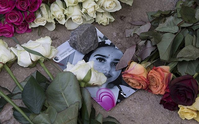 Roses cover the photo of the 14-year-old Susanna Maria Feldman killed in Wiesbaden, Germany