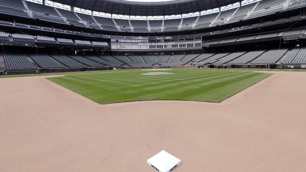 Second base sits in its place in an otherwise empty ballpark where grounds crew members continue to keep the Seattle Mariners' field