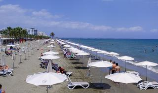 People gather at Mackenzie beach in the coastal city of Larnaca on the Mediterranean island of Cyprus