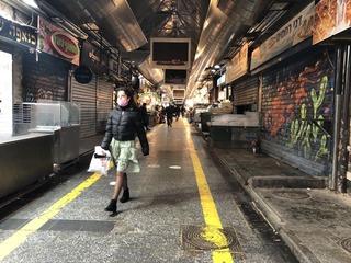 Woman walks through an abandoned Mahane Yehuda market in Jerusalem during COVID-19 pandemic
