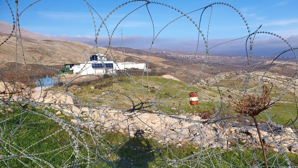 An enclave beyond the fence border Syria Syrian paratroopers barrel army