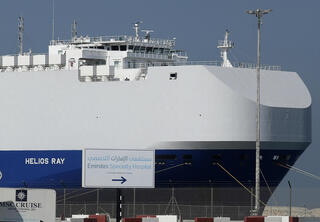 Israeli-owned cargo ship Helios Ray sits docked in port in Dubai, Feb. 28, 2021