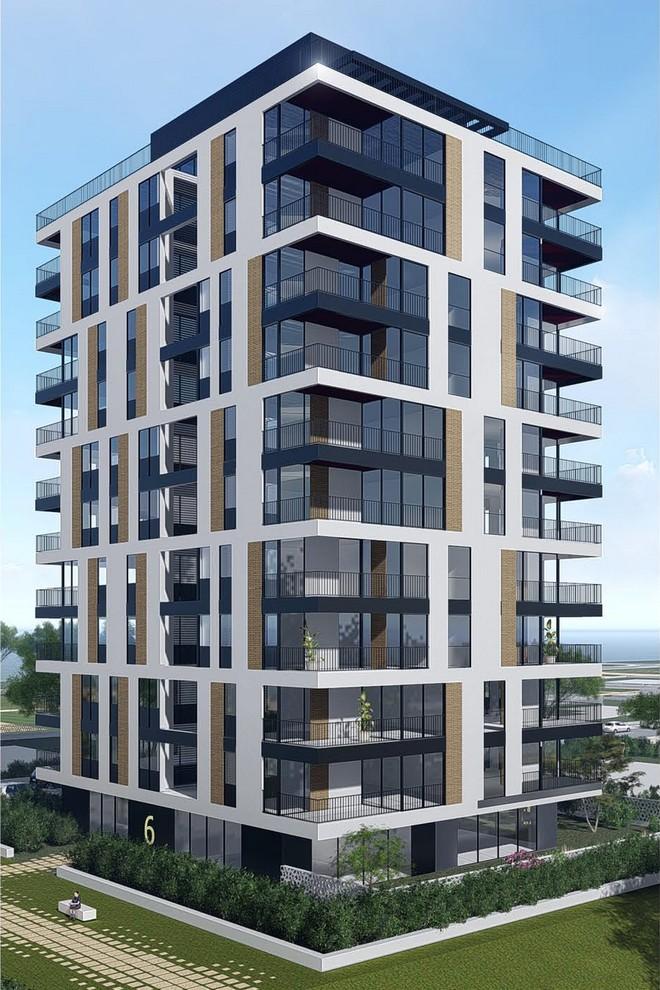 בניין מגורים בעיצוב בר אוריין. דגש על צמצום תחושת הגובה והחלוקה לקומות רבות על ידי איחוד 2 קומות בעיצוב החזית