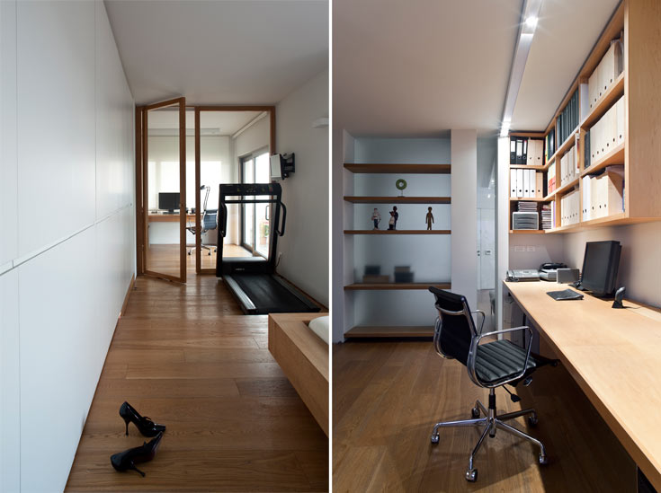 קיר מזכוכית חלבית נבנה בין שני עמודים תומכים ומפריד בין חדר העבודה לבין חלל הפרזנטציות. על הזכוכית נתלו מדפים מעץ אלון (צילום: עמית גרון)
