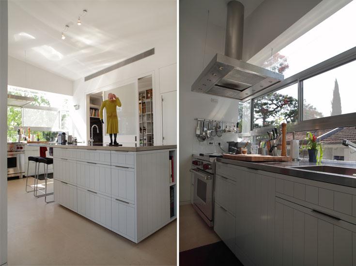 ''אי'' עבודה שעליו משטח נירוסטה מוקם בלב הבית. המקרר שמולו נצבע בצבע הקיר, כדי להצניעו ככל האפשר (צילום: אמית הרמן)